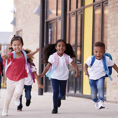 Happy kids running at nursery school